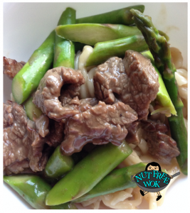 Asparagus with beef, served over udon noodles.