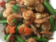 Shrimp stir fry in a white serving dish Happiness is a Shrimp Stir Fry with Spring Vegetables Recipe