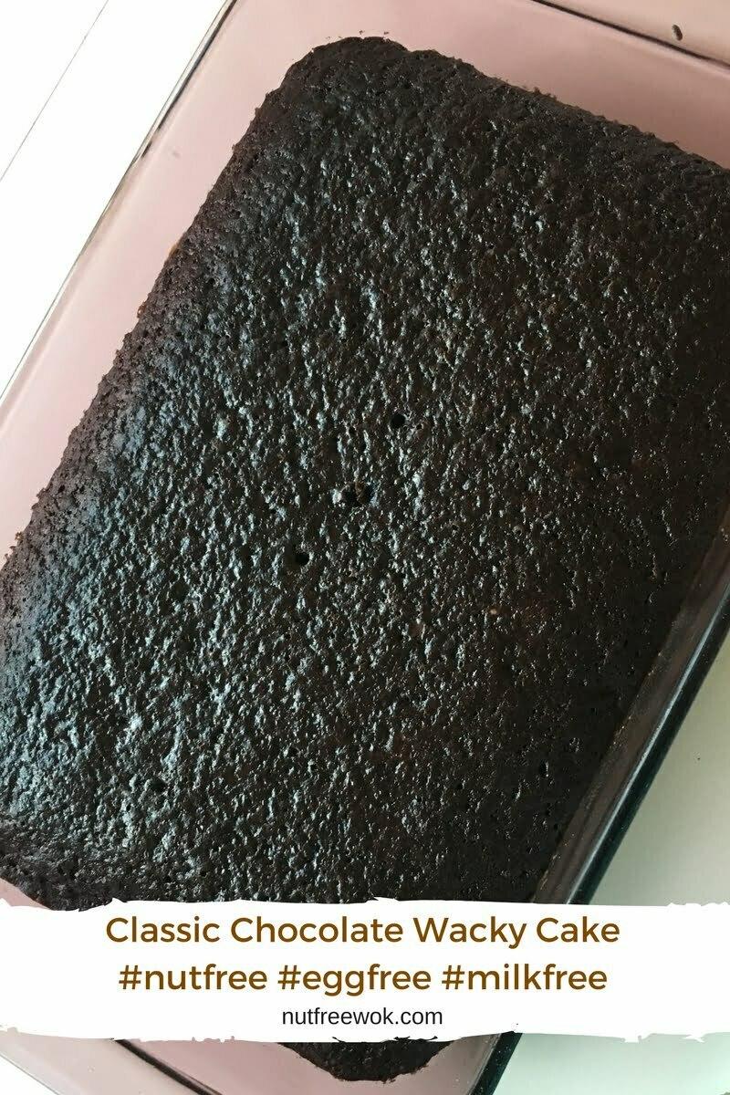 Classic Chocolate wacky cake baked in a 9x13 pan, looks very dark and chocolatey.