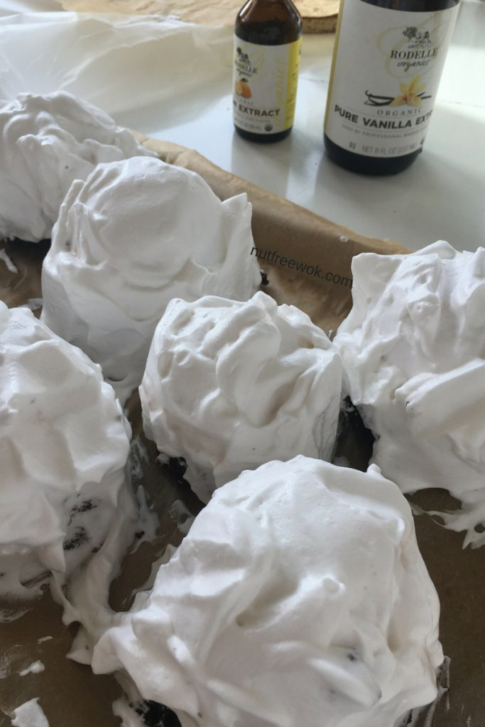Close up of assembled aquafaba baked alaskas ready to go back into the freezer.