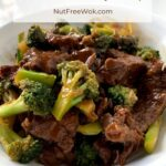 Broccoli Beef is ready to eat, photographed in a white serving bowl.