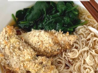Shoyu ramen with panko breaded chicken and spinach in a white bowl with chopsticks and a soup spoon